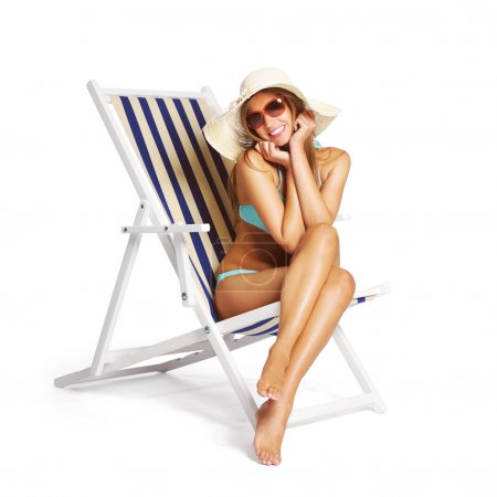 Photo for Beautiful young woman relaxing on beach chair, white background - Royalty Free Image