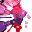 Image of bright-colored nail polish spilling from ...