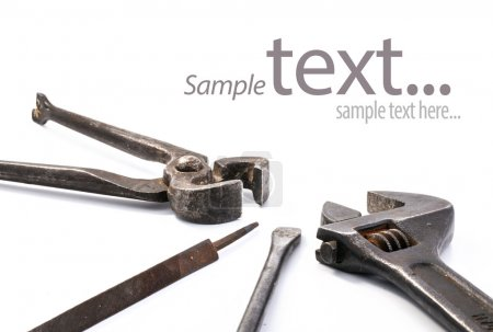 Photo for Vintage tools isolated on white background (with sample text) - Royalty Free Image