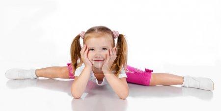 Gymnast cute little girl isolated