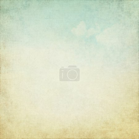 White canvas texture as old grunge background with delicate blue sky ans white clouds view