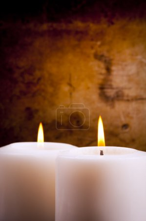Photo for White candles burning with a textured vintage background - Royalty Free Image