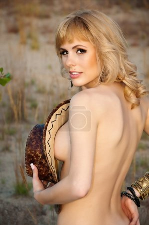 Naked beautiful blonde with a cowboy hat