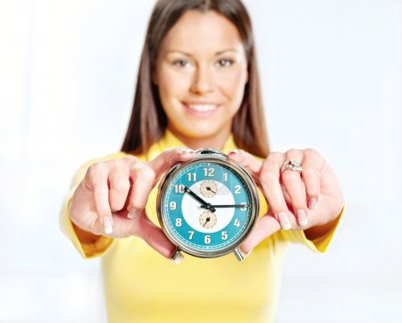 Photo for Analog alarm clock and woman - Royalty Free Image
