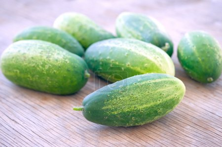 Photo for Fresh cucumbers on wooden surface - Royalty Free Image
