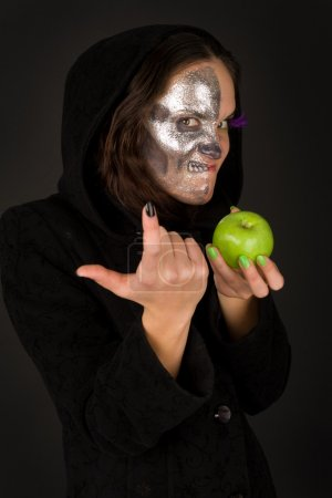 Two-faced sorceress with green apple tempts