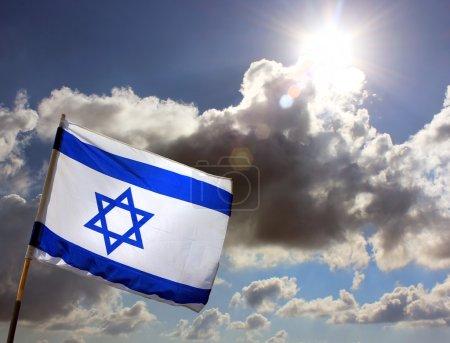Israeli flag against cloudy sky