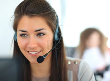 Photo for Female customer support operator with headset and smiling - Royalty Free Image