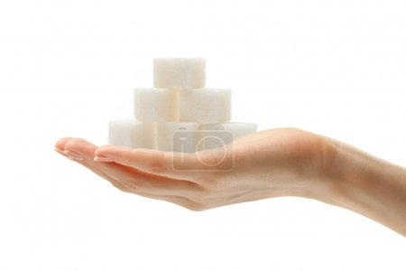 Photo for Female hand with sugar cubes - Royalty Free Image