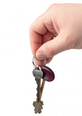 Keys in a hand isolated on white.