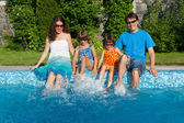 Family summer vacation, fun near swimming pool