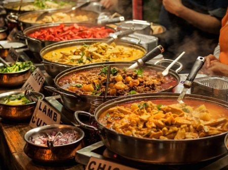 Photo for Oriental food - Indian takeaway at a London's market - Royalty Free Image