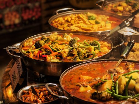 Photo for Vegetable curry - Indian takeaway at a London's market - Royalty Free Image