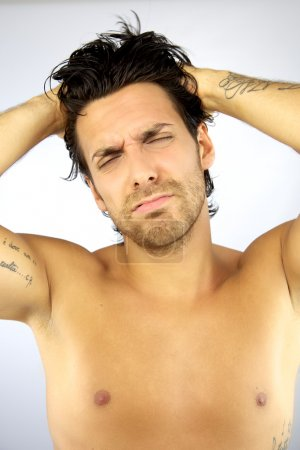 Handsome man stressed because of headache