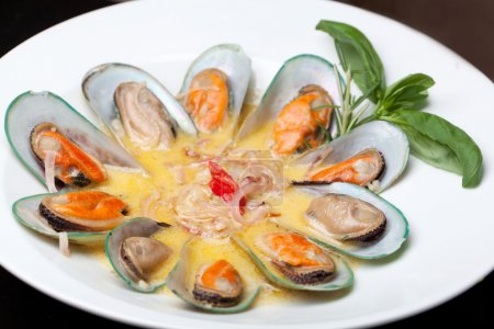 Photo for Mussels cooked in white sauce - Royalty Free Image