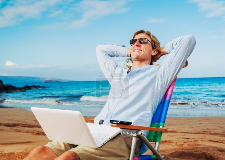 Photo for Young Business Man Relaxing on Tropical Beach - Royalty Free Image