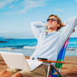 Young Business Man Relaxing on Tropical Beach...