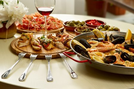 Photo for Spanish paella dinner on the table - Royalty Free Image