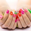 Multi-colored jelly sweets in the hands with a bri...