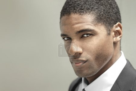 Photo for Portrait of a good looking handsome young businessman in black suit - Royalty Free Image