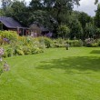 House with english garden and green grass
