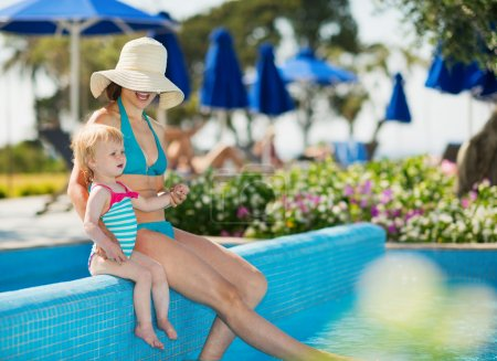 Photo for Mother with baby enjoying pool - Royalty Free Image