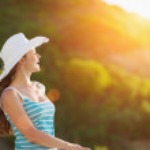 Portrait of happy woman on vacation enjoying sunse...