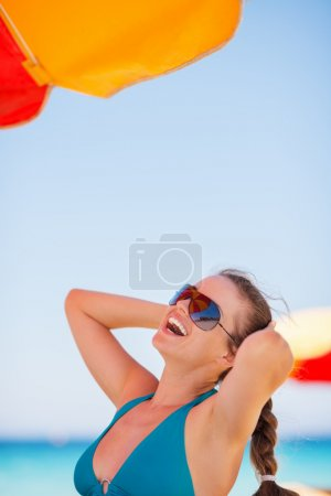 Portrait of woman enjoying vacation on beach