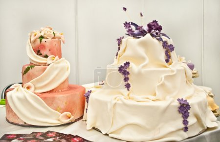 Photo for Exhibition of cakes to wedding fair in Galati-Romania 2012.Traditional wedding cakes. - Royalty Free Image