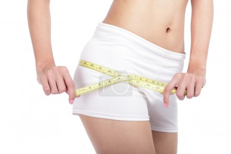 Close up Woman measuring shape of hips