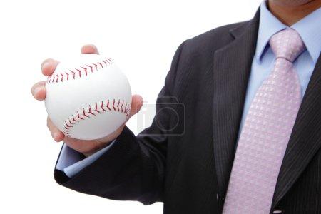 Business man hand holding baseball