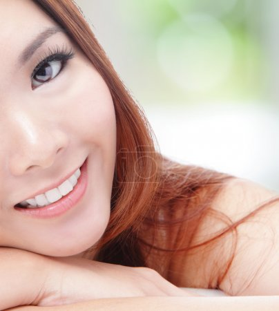 Half face young woman smile with health teeth