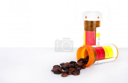 Photo for Coffee beans spilling out of a perscription bottle, isolated white background - Royalty Free Image