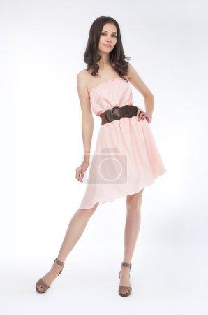 Beauty - fashionable girl in light dress standing