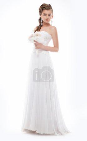 Gorgeous woman in white fashion bridal dress