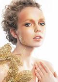 Gold bright make-up. Beauty woman face. Creativity