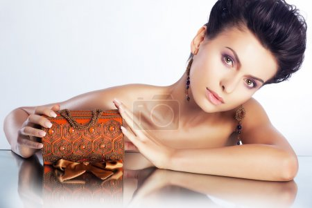 Sexy woman with jewellery luxury box - clean healthy skin
