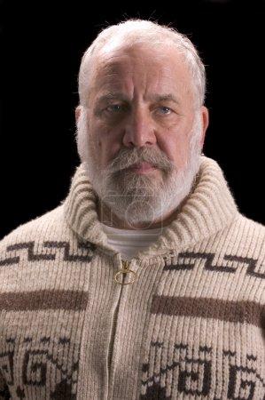 Old man with beard in sweater like Ernest Hemingway