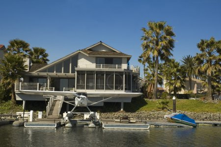 Executive house on the water with seaplane