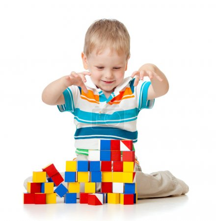 Kid playing toy blocks isolated on white background