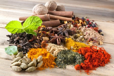Photo for Mixture of beautiful spices and herbs on a wooden table - Royalty Free Image