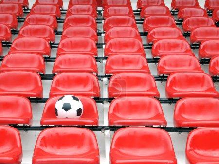 Photo pour Football sur des chaises de stade - image libre de droit