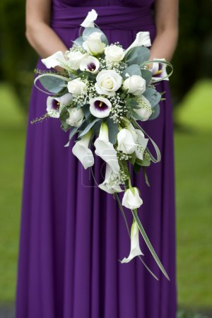 Bridesmaid in purple with wedding bouquet