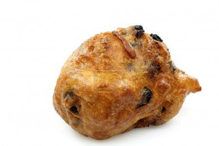 Traditional Dutch oliebol baked with currents