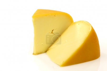 Photo for Traditional Gouda cheese pieces on a white background - Royalty Free Image