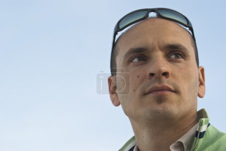 Photo for Young handsome man full of ideas looking up on the sky background - Royalty Free Image