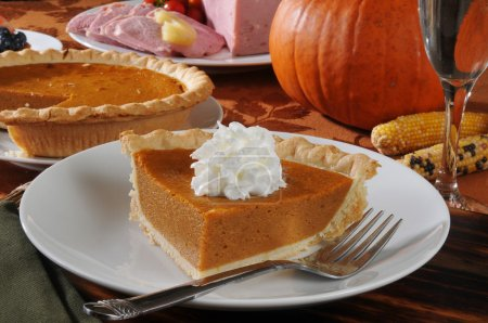 Photo for A slice of pumpkin pie with whipped cream for the holidays - Royalty Free Image