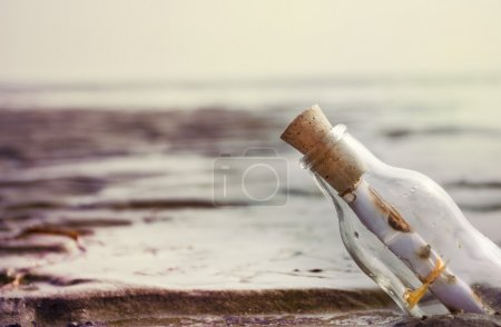 Photo for Message in the bottle on the beach - Royalty Free Image