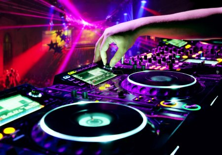 Photo for Dj mixes the track in nightclub at party - Royalty Free Image