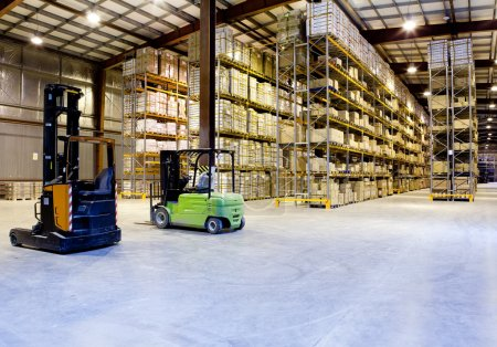 Photo for Large modern warehouse with forklifts - Royalty Free Image